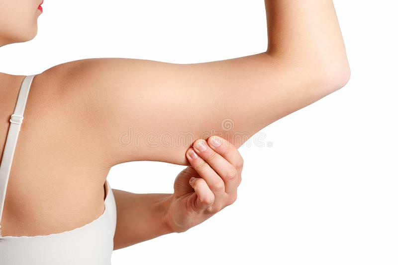 Beauty Portrait Woman pinching Arm Fat Flabby Skin, Hand and Body Care. smooth skin. On white stock photos