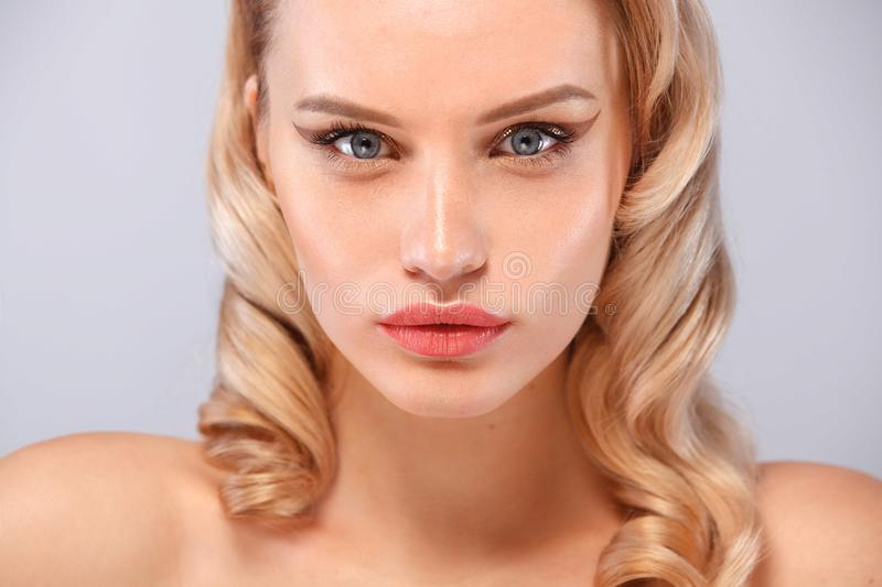 Beauty portrait of female face with natural skin and nude makeup stock photo