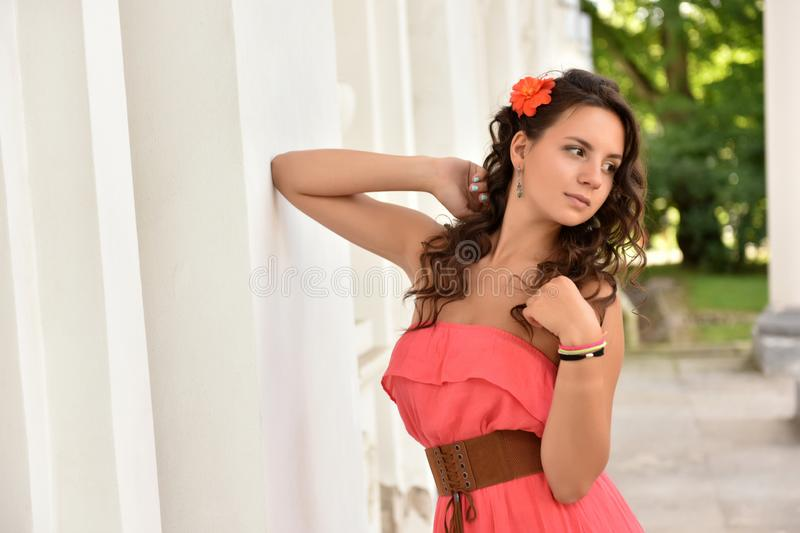 Portrait of young adult woman dressed pink dress royalty free stock images
