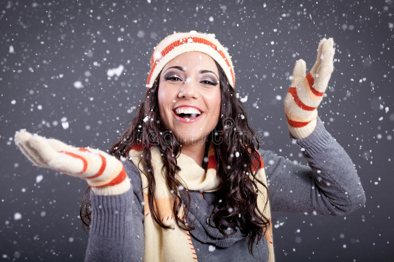 Beauty portrait of young attractive woman over snowy Christmas b stock image
