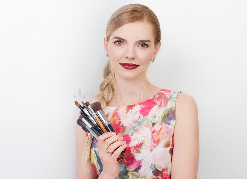 Beauty portrait of young beautiful cheerful young fresh looking make up artist lady with bright trendy make up long blond healthy. Beauty portrait of young royalty free stock images