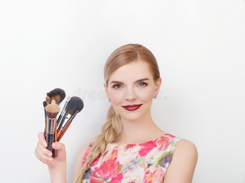 Beauty portrait of young beautiful cheerful young fresh looking make up artist lady with bright trendy make up long blond healthy. Beauty portrait of young royalty free stock photo
