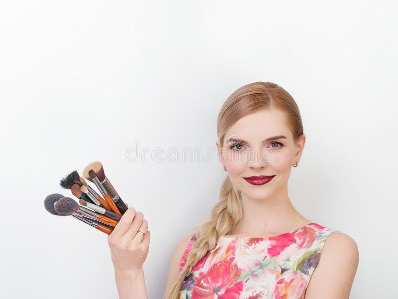 Beauty portrait of young beautiful cheerful young fresh looking make up artist lady with bright trendy make up long blond healthy. Beauty portrait of young stock photo