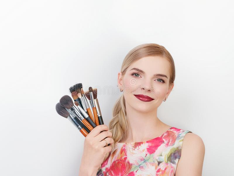 Beauty portrait of young beautiful cheerful young fresh looking make up artist lady with bright trendy make up long blond healthy. Beauty portrait of young stock images