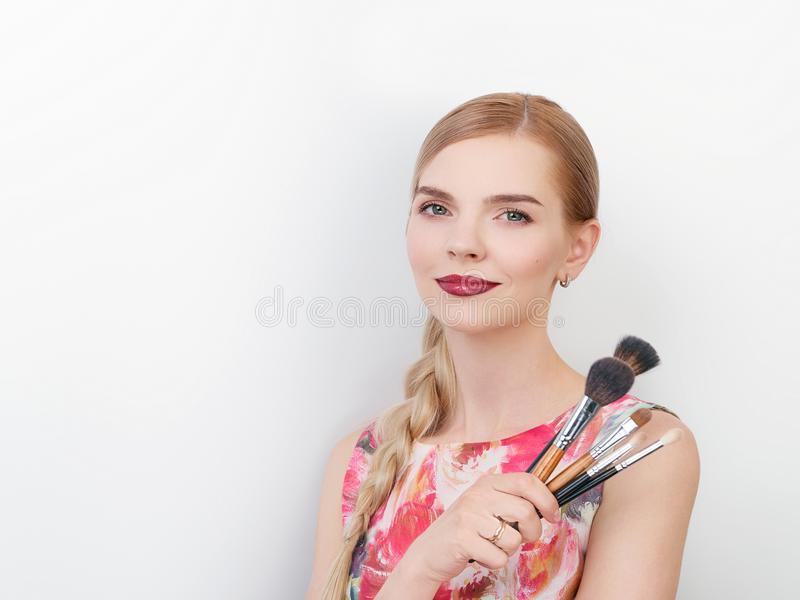 Beauty portrait of young beautiful cheerful young fresh looking make up artist lady with bright trendy make up long blond healthy. Beauty portrait of young stock image