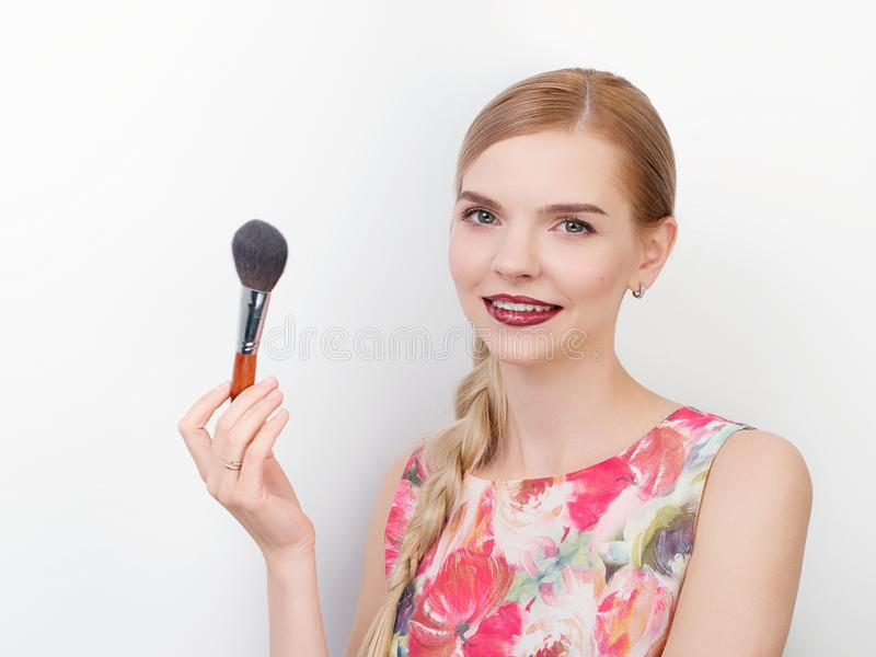 Beauty portrait of young beautiful cheerful young fresh looking make up artist woman with bright trendy make up long blond healthy. Beauty portrait of young royalty free stock photo