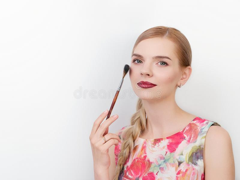 Beauty portrait of young beautiful cheerful young fresh looking make up artist woman with bright trendy make up long blond healthy. Beauty portrait of young stock image