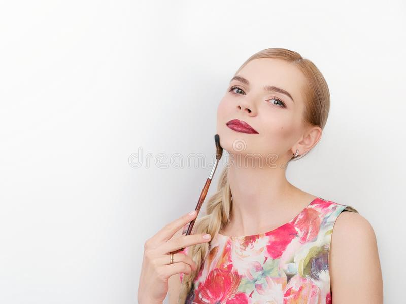 Beauty portrait of young beautiful cheerful young fresh looking make up artist woman with bright trendy make up long blond healthy. Beauty portrait of young stock photo