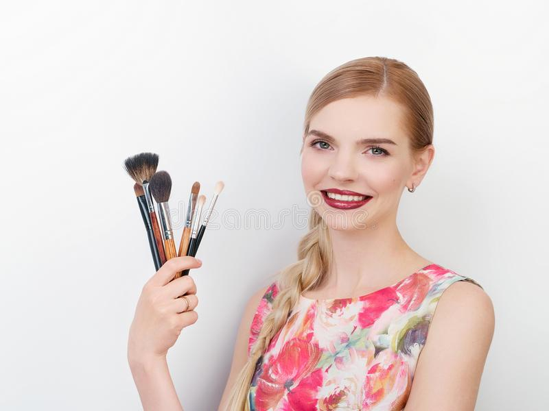Beauty portrait of young beautiful cheerful young fresh looking make up artist lady with bright trendy make up long blond healthy. Beauty portrait of young stock photos