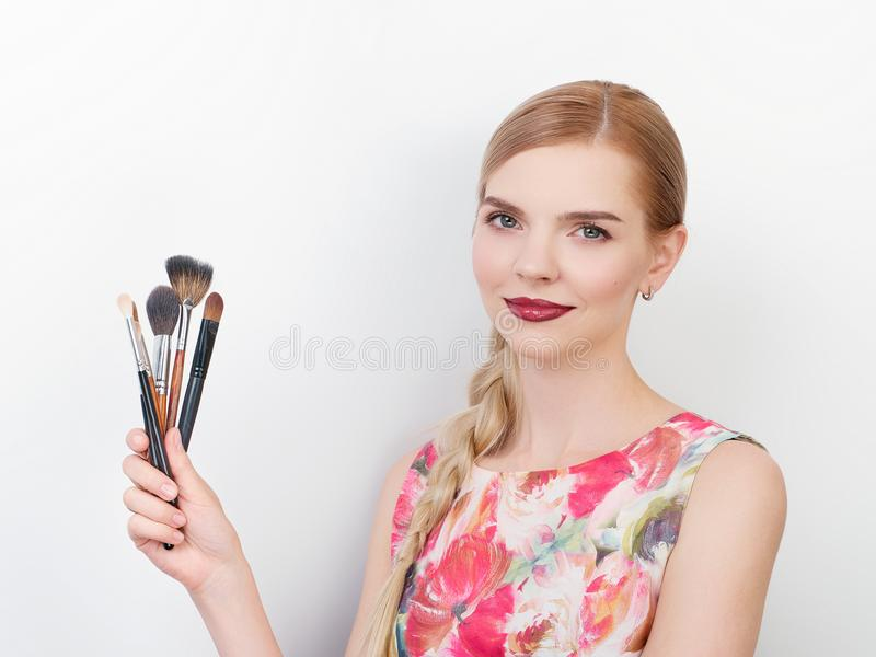 Beauty portrait of young beautiful cheerful young fresh looking make up artist lady with bright trendy make up long blond healthy. Beauty portrait of young royalty free stock photos