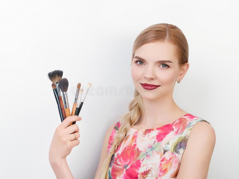 Beauty portrait of young beautiful cheerful young fresh looking make up artist lady with bright trendy make up long blond healthy. Beauty portrait of young stock photography