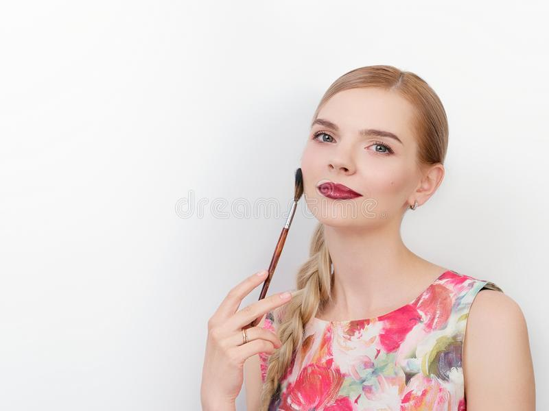 Beauty portrait of young beautiful cheerful young fresh looking make up artist woman with bright trendy make up long blond healthy. Beauty portrait of young stock photography