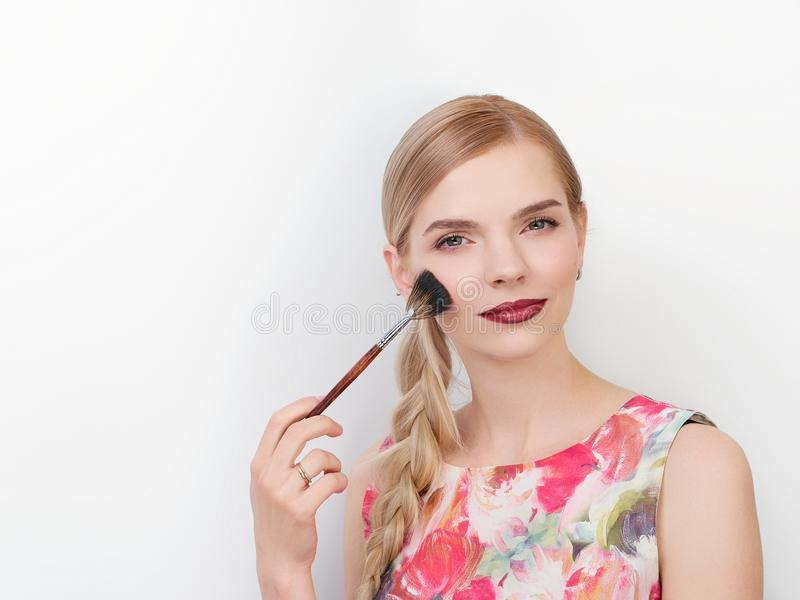 Beauty portrait of young beautiful cheerful young fresh looking make up artist woman with bright trendy make up long blond healthy. Beauty portrait of young royalty free stock photos