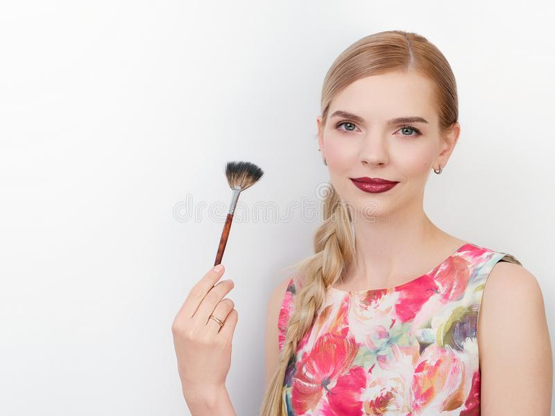 Beauty portrait of young beautiful cheerful young fresh looking make up artist woman with bright trendy make up long blond healthy. Beauty portrait of young royalty free stock photography