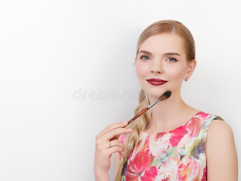 Beauty portrait of young beautiful cheerful young fresh looking make up artist woman with bright trendy make up long blond healthy. Beauty portrait of young stock photos