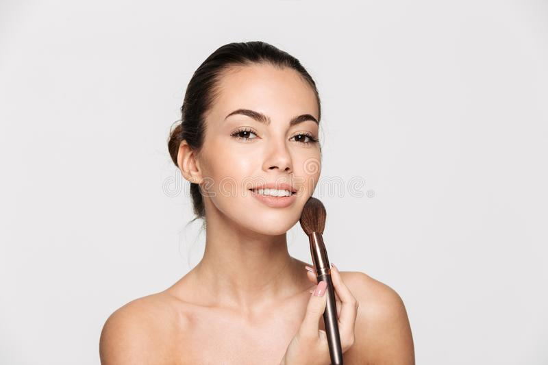 Beauty portrait of a young beautiful half naked woman royalty free stock images