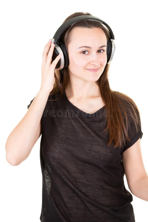 Beauty portrait of young fresh looking woman posing in big silver black professional dj headphones stock photography