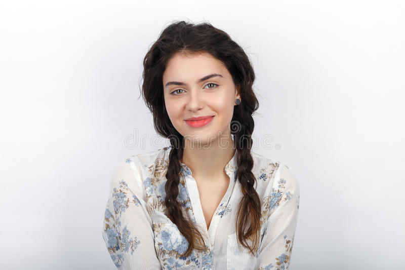 Beauty portrait of young smiling fresh looking brunette woman with long brown healthy curly braided hair. Emotion and facial expre royalty free stock photography