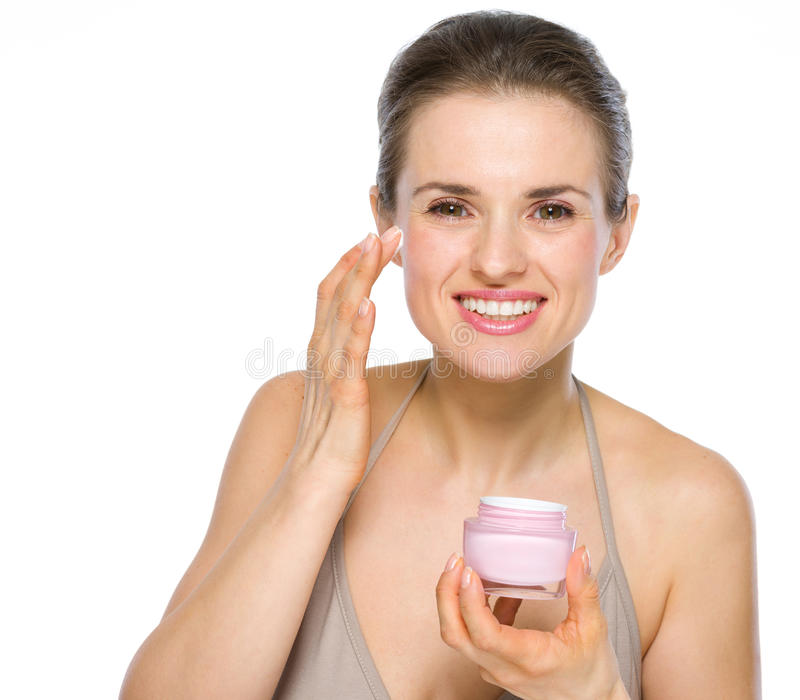 Beauty portrait of young woman applying creme stock image