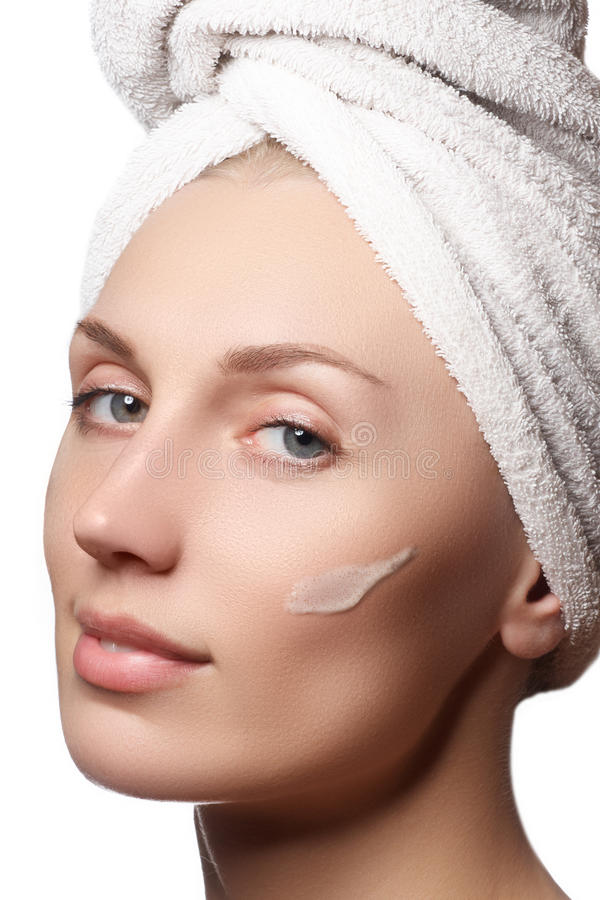 Beauty portrait of a young woman with beautiful healthy person, studio shot attractive girl on a white background, causing a scrub. On face. Peeling face stock photo