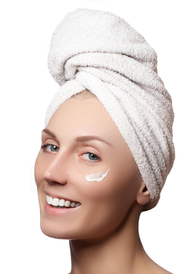 Beauty portrait of a young woman with beautiful healthy person. Studio shot attractive girl on a white background, causing a scrub on face. Peeling face stock photo