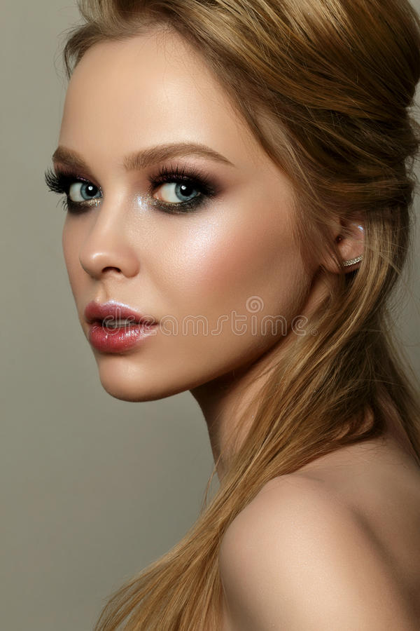 Beauty portrait of young woman with classic makeup royalty free stock photos