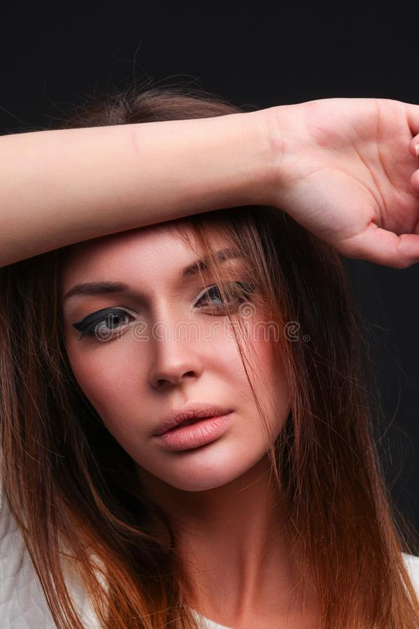 Beauty. Portrait of a young woman on dark background stock photo