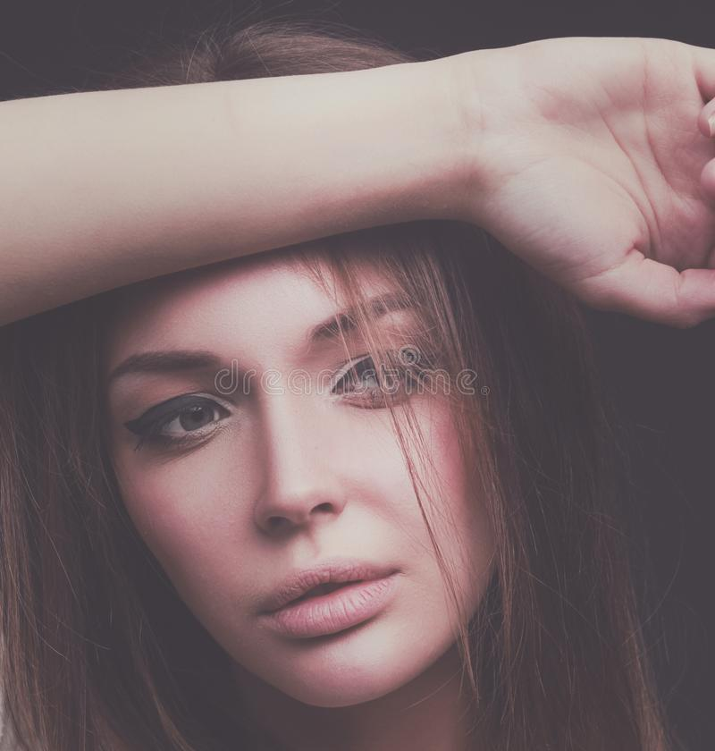 Beauty. Portrait of a young woman on dark background stock photography