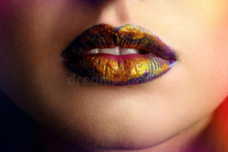 Beauty portrait of a lips of a young woman royalty free stock image