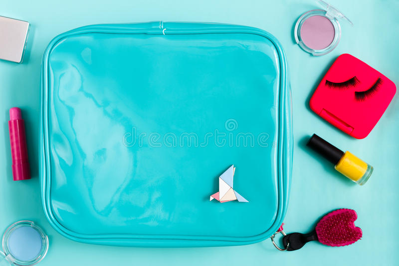 Beauty products, cosmetic bag with essentials stock photos