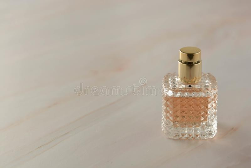 Beauty products. Perfume or parfume bottle on marble background. Copy space royalty free stock image