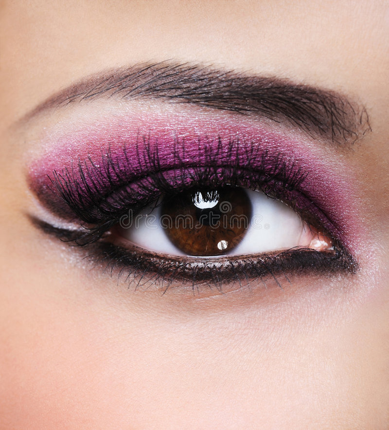 Beauty purple make-up. Front view of beauty female eye with purple make-up