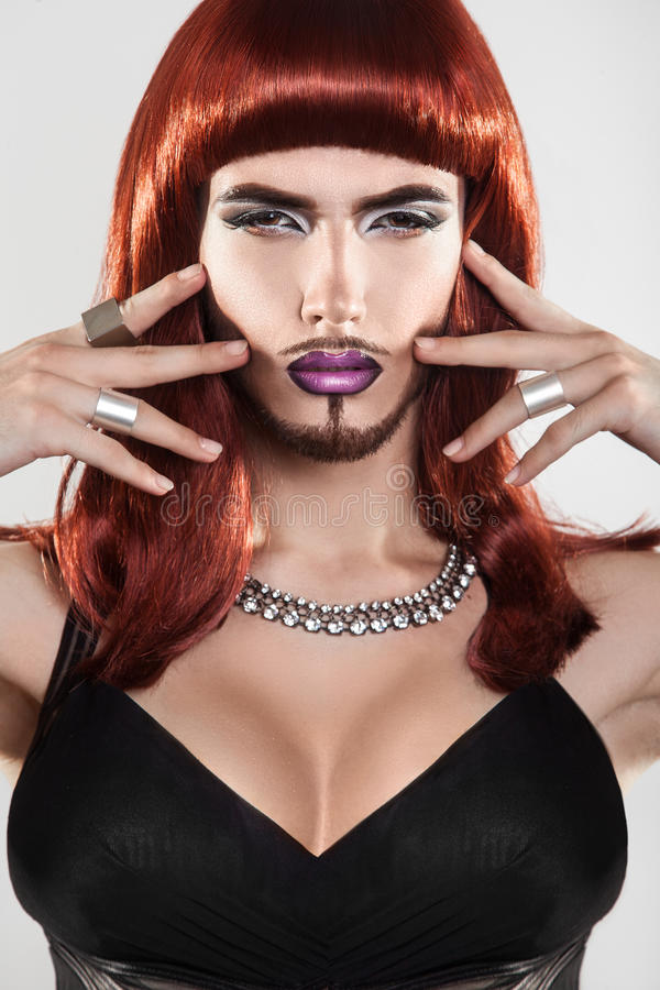 Beauty Red Hair Shemale With Beard And Makeup Stock Image