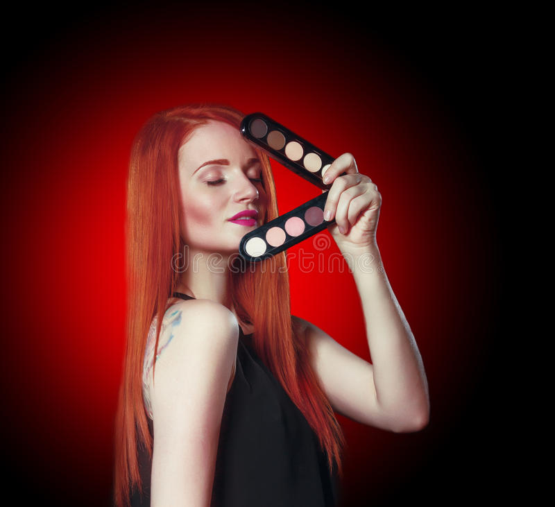 Beauty red head girl with makeup eye shadows royalty free stock photos