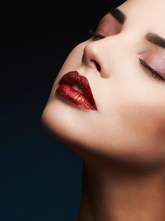 Beauty Red Lips Makeup Detail. Beautiful Sensual woman. glitter lips,lipstick or Lip gloss royalty free stock photos