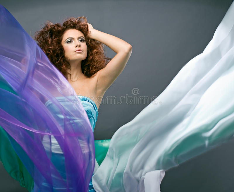 Beauty Redheaded Girl In Fashion Dress Royalty Free Stock Photography