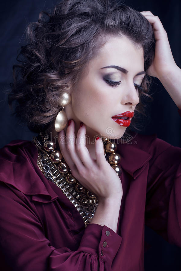 Beauty rich brunette woman with a lot of jewellery. Hispanic curly lady stock photos