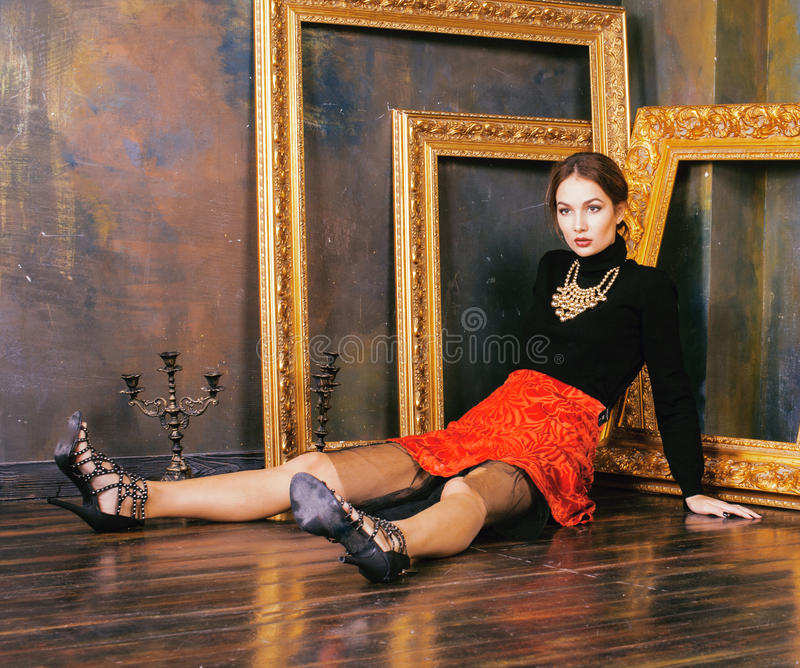 Beauty rich brunette woman in luxury interior near empty frames, vintage elegance royalty free stock images