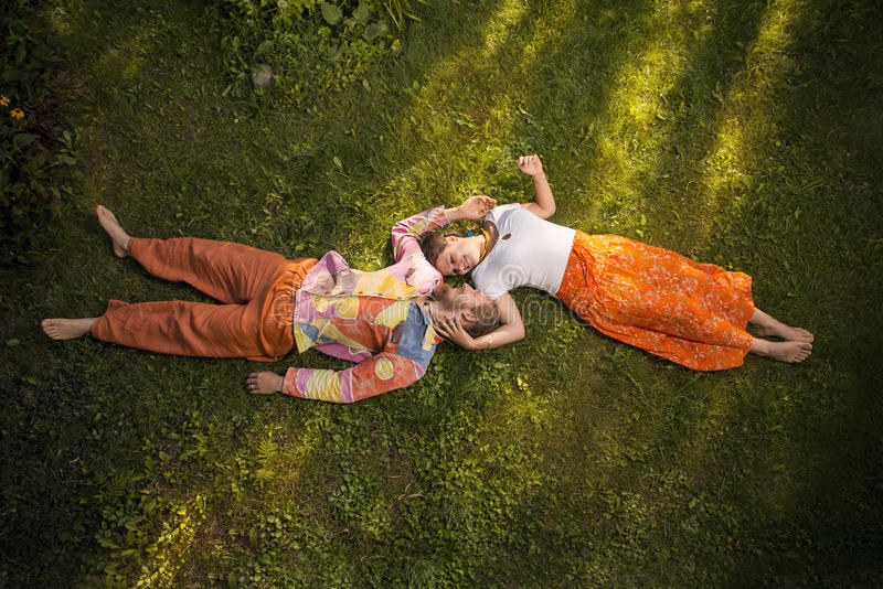 Beauty romantic couple embracing lying outdoors royalty free stock photography