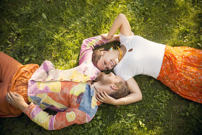 Beauty romantic couple embracing lying outdoors royalty free stock image
