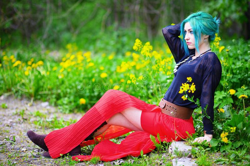 Beauty romantic girl with green hair in park royalty free stock image