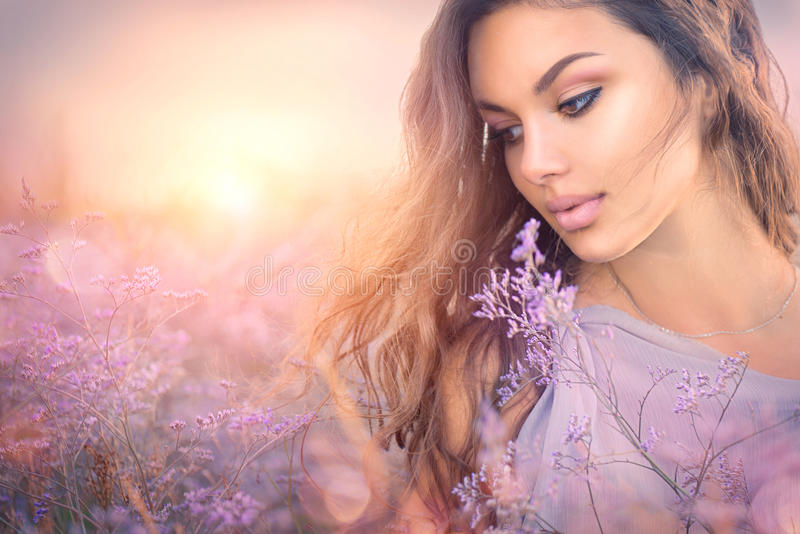 Beauty romantic girl portrait. Beautiful woman enjoying nature. Over sunset royalty free stock images