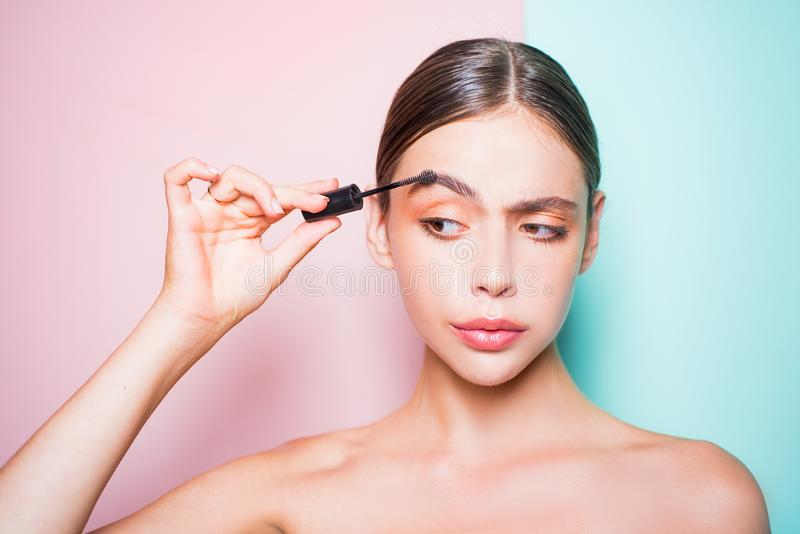 Beauty routine. Girl hold cosmetic applicator. Woman put makeup on her face. Daily makeup concept. Makeup and cosmetics. Girl healthy shiny skin put makeup on stock image