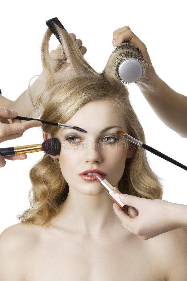 In beauty salon, the girl looks at right stock photos