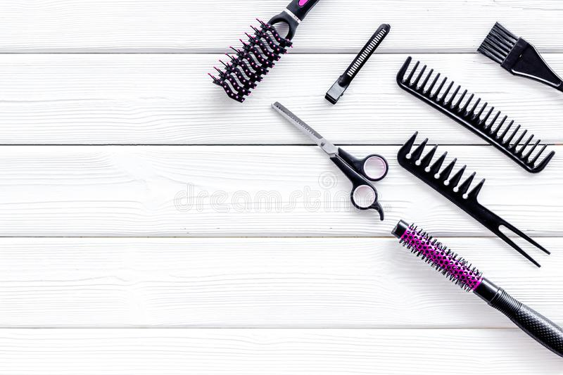 Hairdresser equipment for cutting hair and styling with combs, sciccors on white wooden background top view copyspace. Beauty salon. Hairdresser equipment for royalty free stock photos
