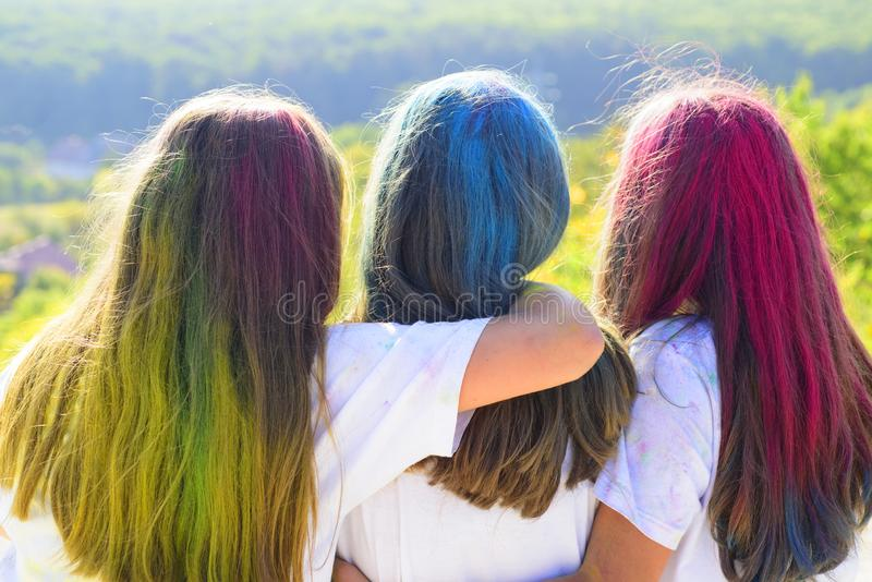 Beauty salon and hairdresser. positive and cheerful. children with creative body art. colorful neon paint hair. Crazy. Hipster girls. Summer weather. Happy royalty free stock photography