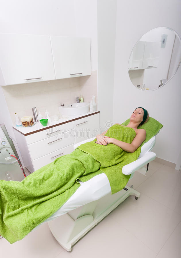 Beauty salon indoor. Woman relaxing in spa clinic stock photo