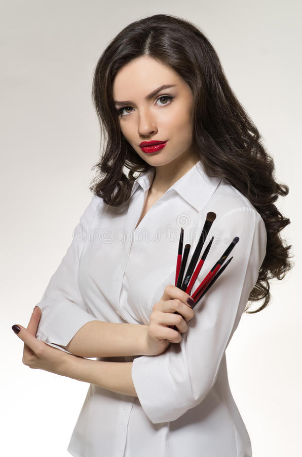 Beauty salon makeup artist with professional brushes stock images