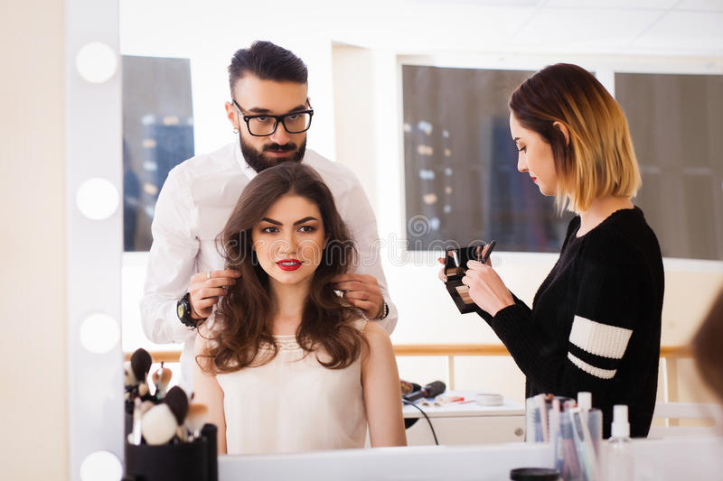 Beauty salon, makeup and styling in the salon, hairdressers and make-up artist, stock photography