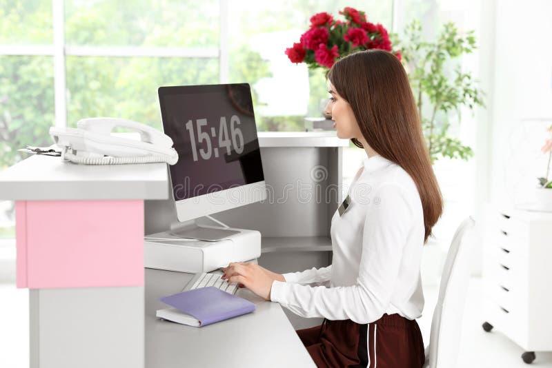 Beauty salon receptionist using computer royalty free stock image